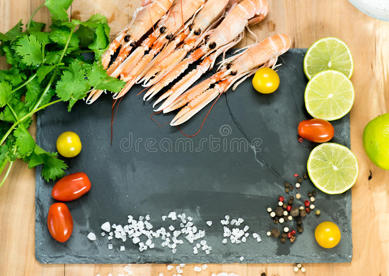 Fresh scampis on the black rock stock photo