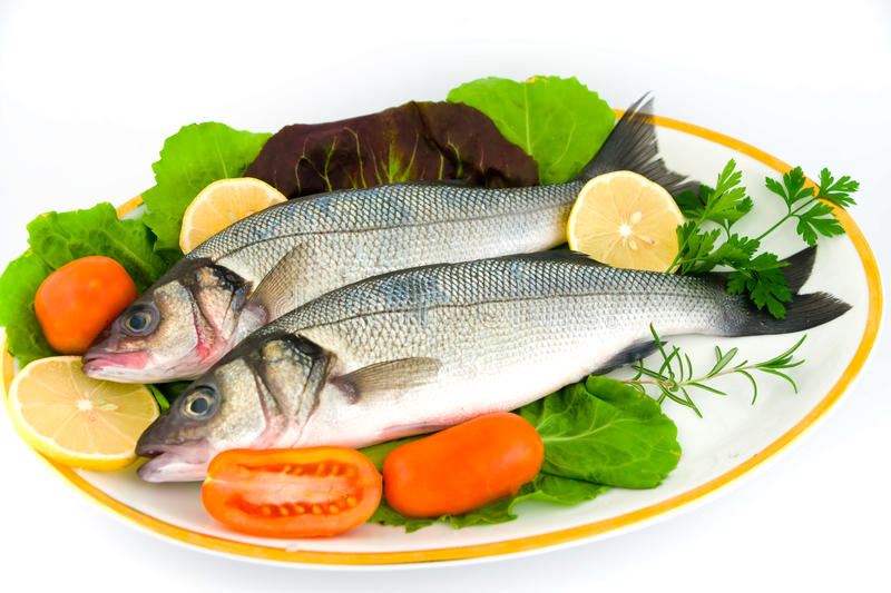 Fresh sea bass. With vegetables, ready to cook stock photo