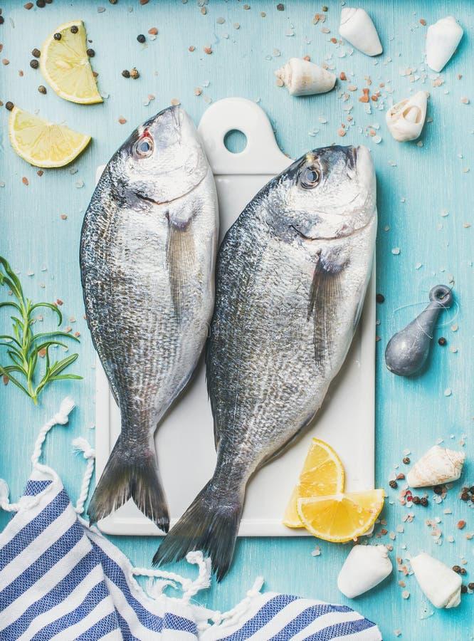 Fresh Sea bream or dorado raw uncooked fish with seasoning stock photography