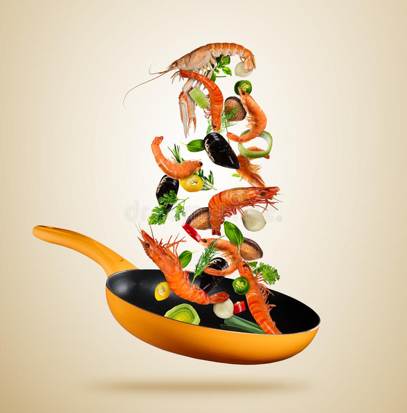 Fresh sea food and vegetables flying into a pan on brown background stock illustration