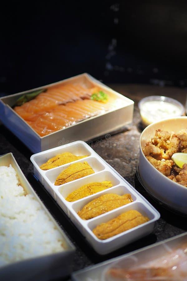 Fresh sea urchin uni, salmon and rice japanese raw food royalty free stock photography
