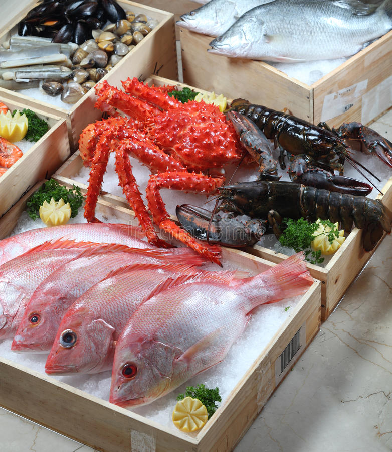 Fresh seafood. In wooden boxes stock images