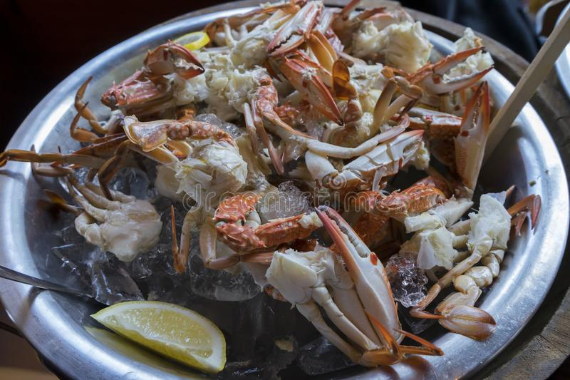 Fresh seafood Blue Sandcrab and lemon in ice Bucket. royalty free stock photos