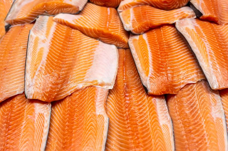 Fresh seafood on crushed ice at fish market. Raw salmon fillet on display counter at store. Fish filleting bacground. Fresh seafood on crushed ice at fish market royalty free stock image