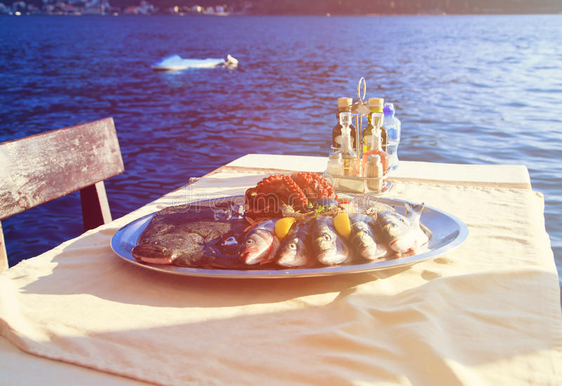 Fresh seafood plate in restaurant near the sea. Fresh seafood plate served in restaurant near the sea royalty free stock photography