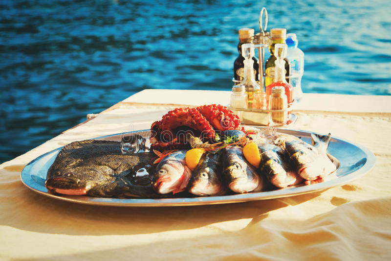 Fresh seafood plate in restaurant at sea. Local food stock photos