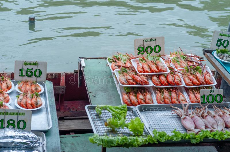 Fresh seafood for sale in the floating market, Bangok, Thailand stock photography