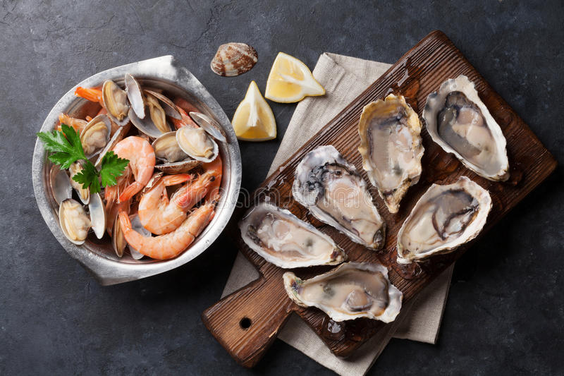 Fresh seafood. Scallops, oysters and shrimps stock images