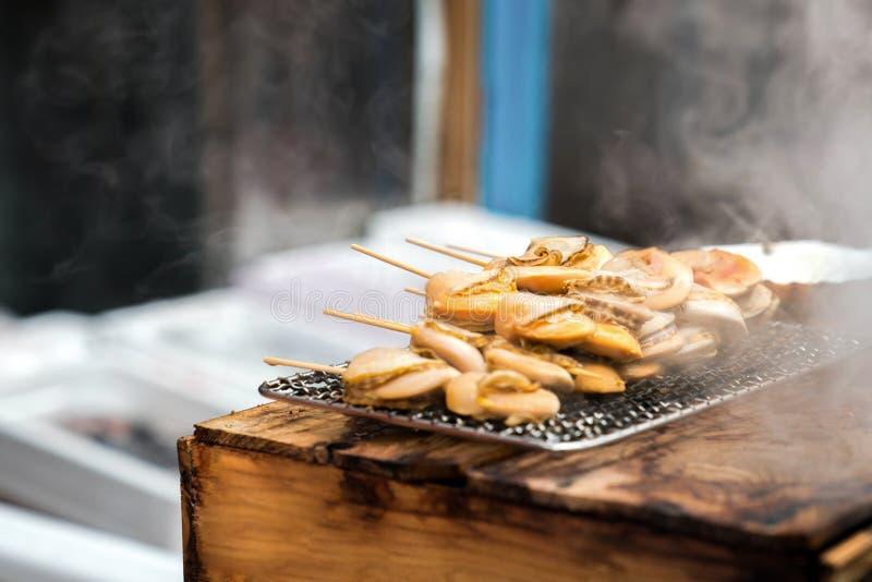 Fresh shellfish at fish market, Japan royalty free stock images