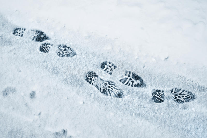 Fresh shoe prints on snow background royalty free stock photography