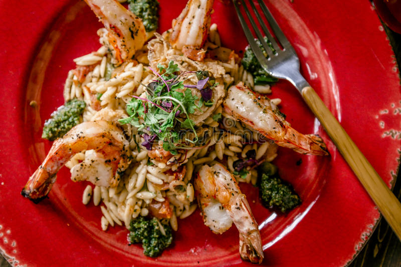 Fresh Shrimp and Risotto with Pesto royalty free stock photography