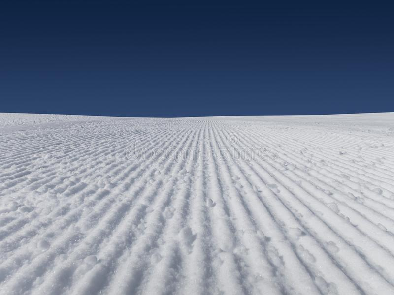 Fresh ski slopes early morning. And blue sky skiing alps French royalty free stock photos