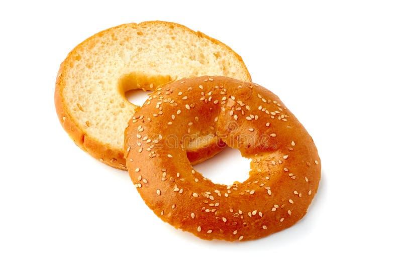 Fresh and sliced bagel on white background. Fresh sliced bagel isolated on white background stock photo