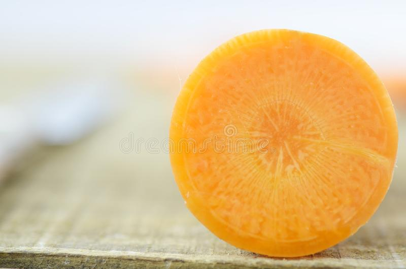 Haft carrot on wooden, detail royalty free stock photography