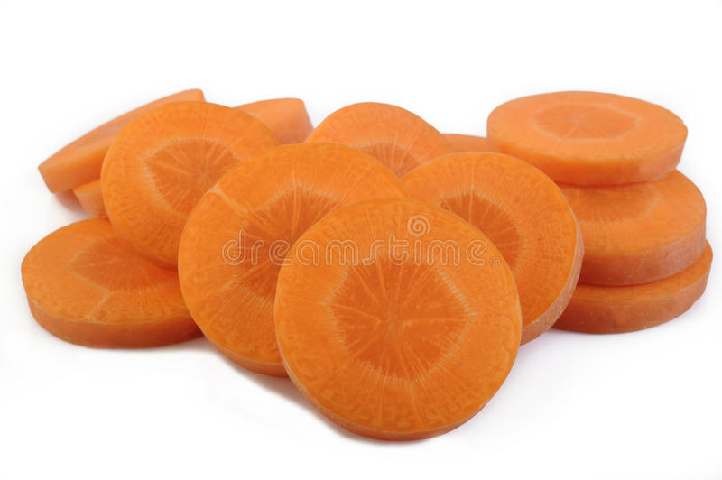 Fresh sliced carrots. On white background stock photography
