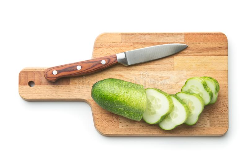 Fresh sliced cucumber. Fresh sliced cucumber isolated on white background. Cucumber on cutting board with knife royalty free stock photography