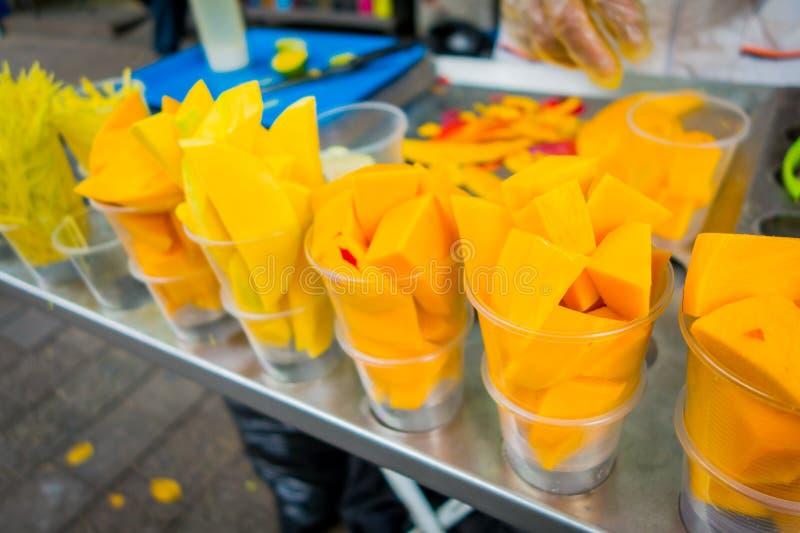 Fresh sliced mango, street food in Medellin. Closeup of fresh sliced delicious mango, street food in Medellin, Colombia royalty free stock image