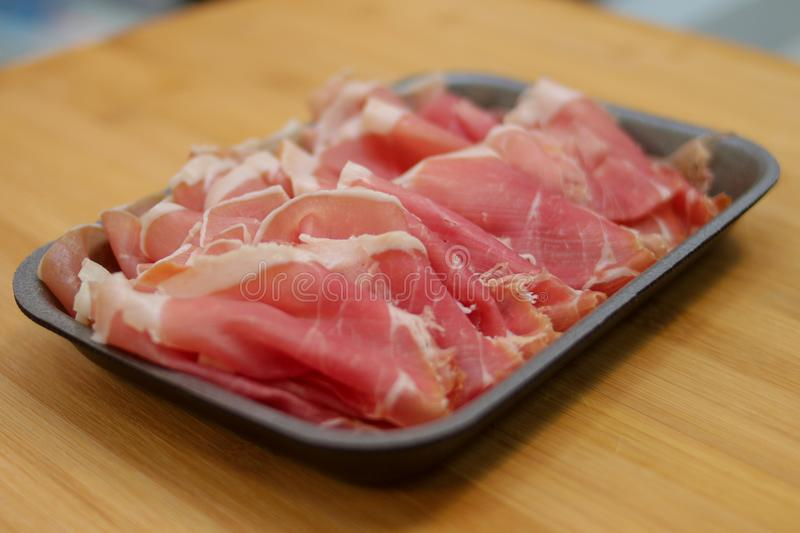 Sliced meat on the market stock image