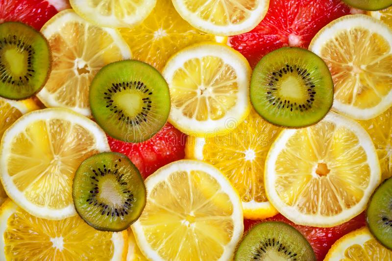 Fresh sliced mixed citrus fruits like background, concept of healthy eating, dieting, top view. Background. royalty free stock photo