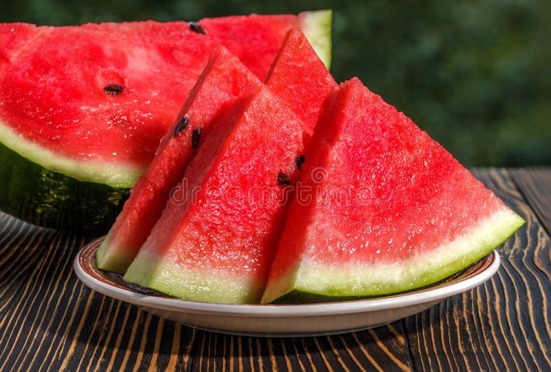 Fresh sliced watermelon wooden background royalty free stock photography
