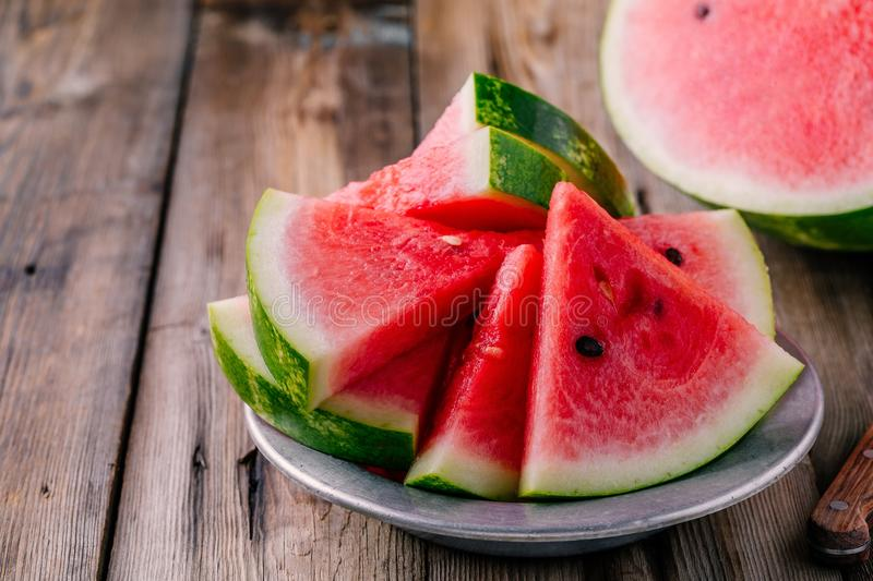 Fresh sliced watermelon on wooden rustic background royalty free stock images