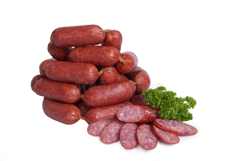 Fresh smoked sausages in a natural shell. Isolated on white background stock photography