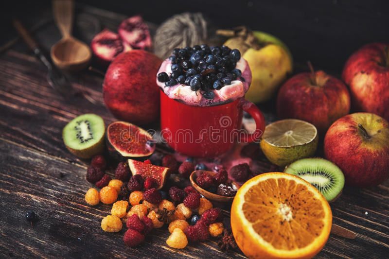 Fresh smoothie on wooden table in the cup royalty free stock image