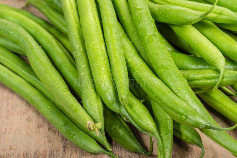 Fresh snap or green beans on a table stock photos