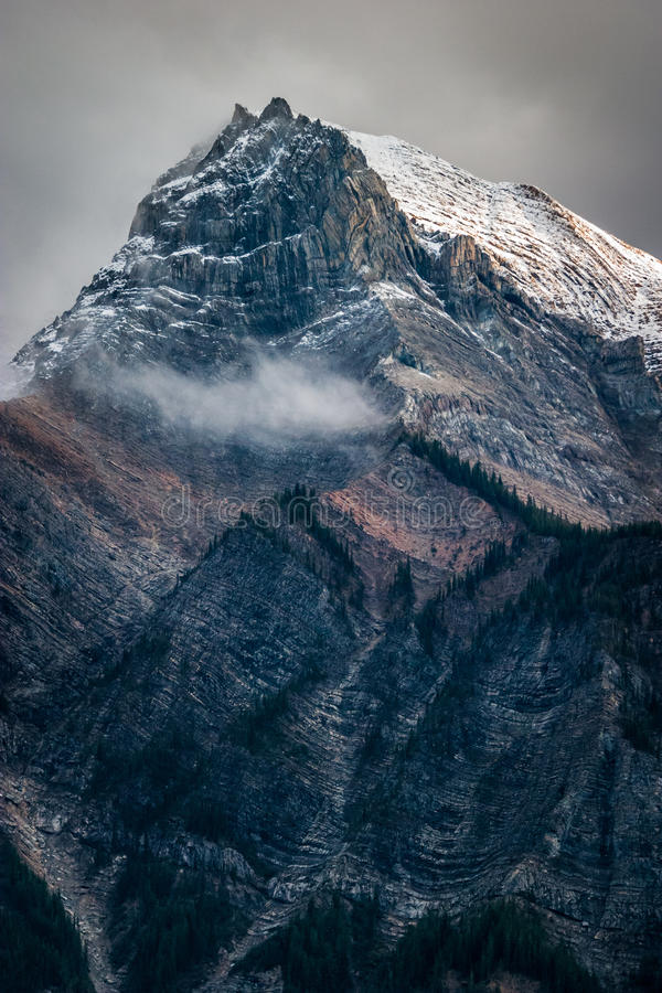 Fresh snow on a mountain peak in the Canadian Rockies, British C stock photography