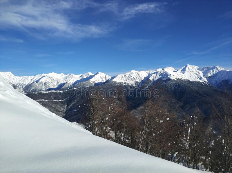 Fresh snow on the mountains royalty free stock photography