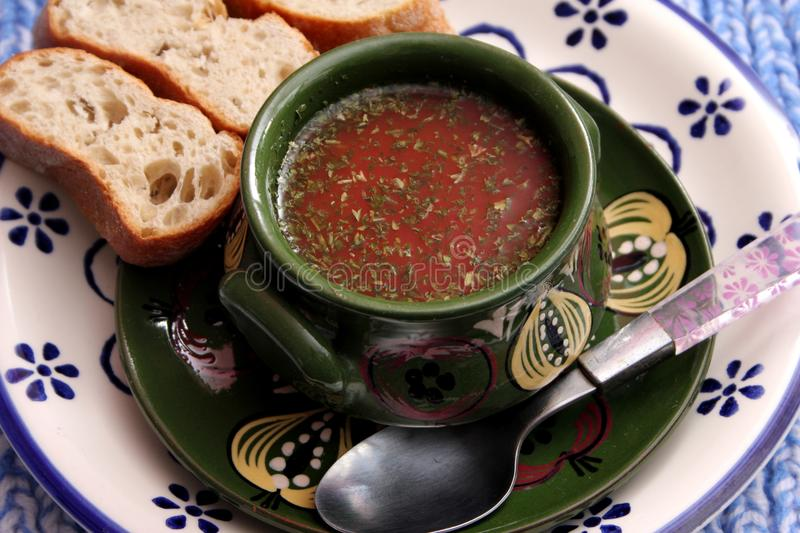 Soup of tomatoes and basil stock photos