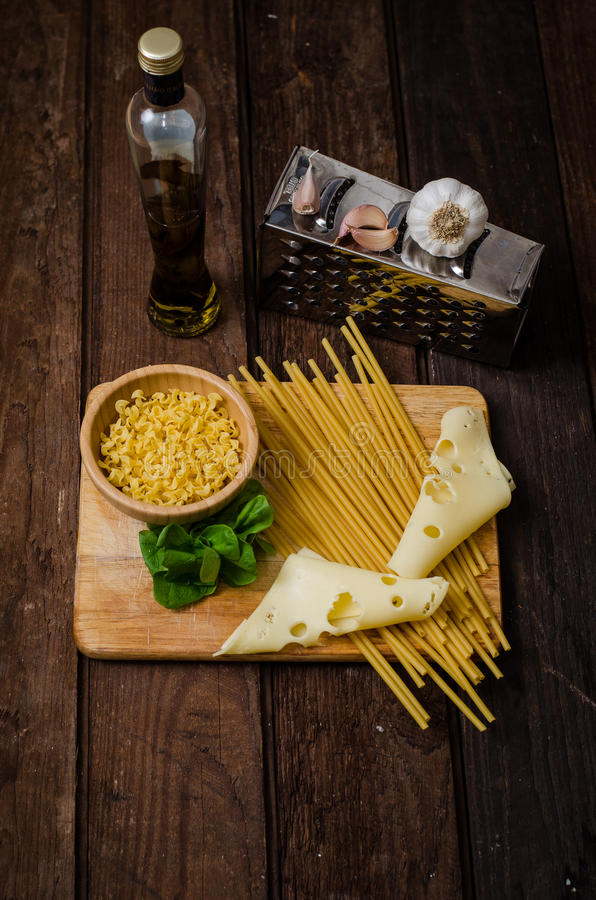 Fresh spaghetti with cheese on an old wooden table.  stock photo