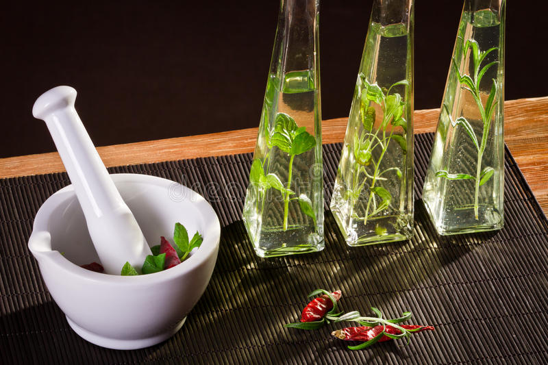 Fresh spices in white mortar stock images