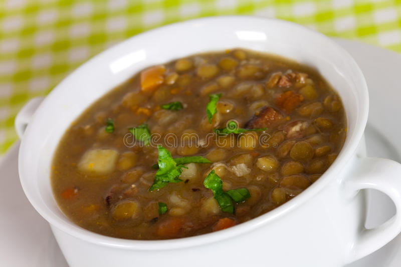 A fresh spoonful of lentil stew stock photos