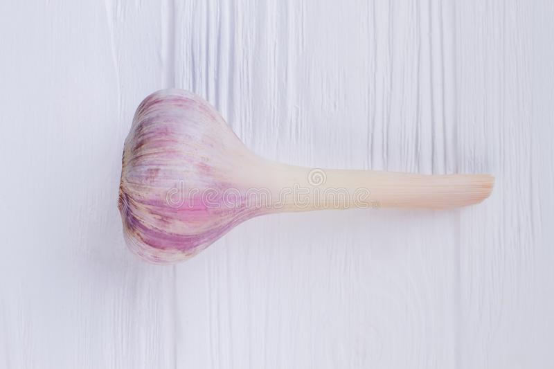 Fresh spring garlic on wooden background. royalty free stock photos