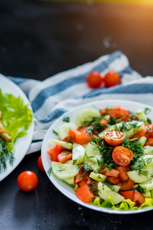 Fresh spring vegetable salad on a black background, close-up royalty free stock photos