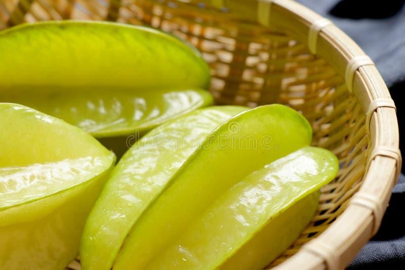 Fresh star fruit. Carambola in bamboo basket.Healthy food. royalty free stock photo