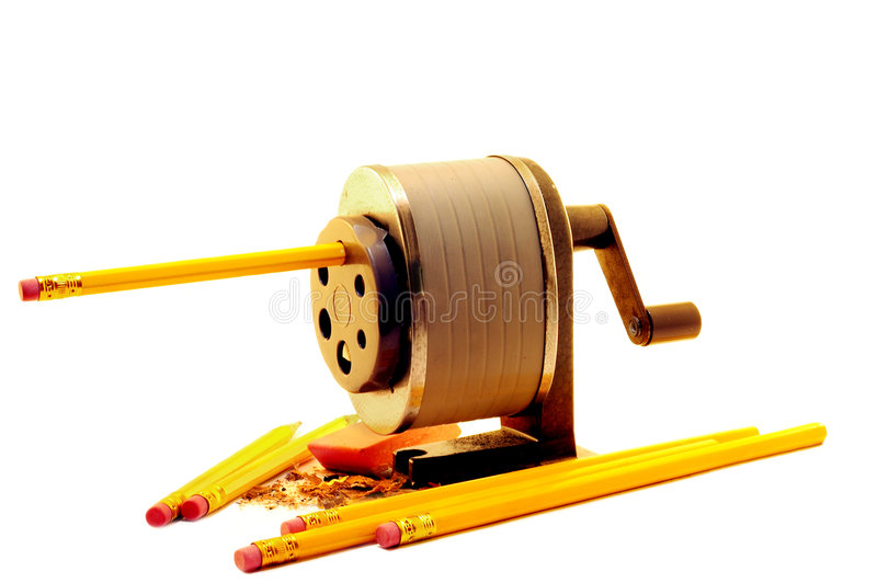 A Fresh Start. New pencils being sharpened with a crank sharpener. Isolated on white stock photo