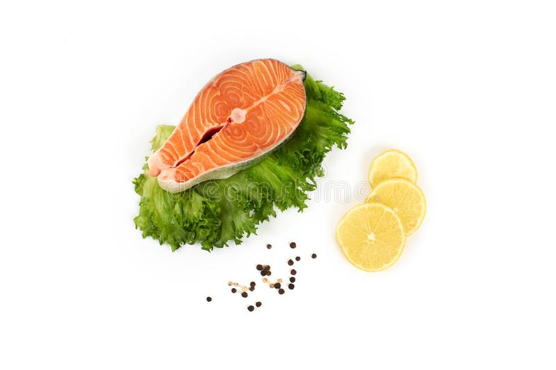 Fresh steak of a salmon with lemon and pepper, isolated on white background. stock photos