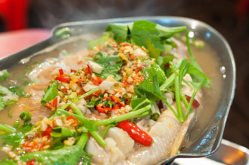 Fresh steamed fish at a local Thai restaurant. BANGKOK, THAILAND - Fresh steamed fish at a local Thai restaurant royalty free stock images