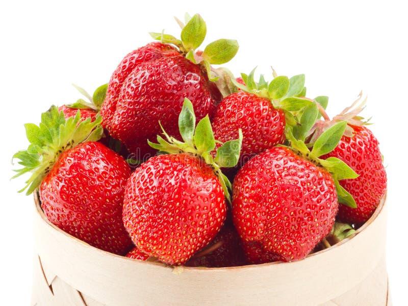 Fresh strawberries in basket on white royalty free stock photos