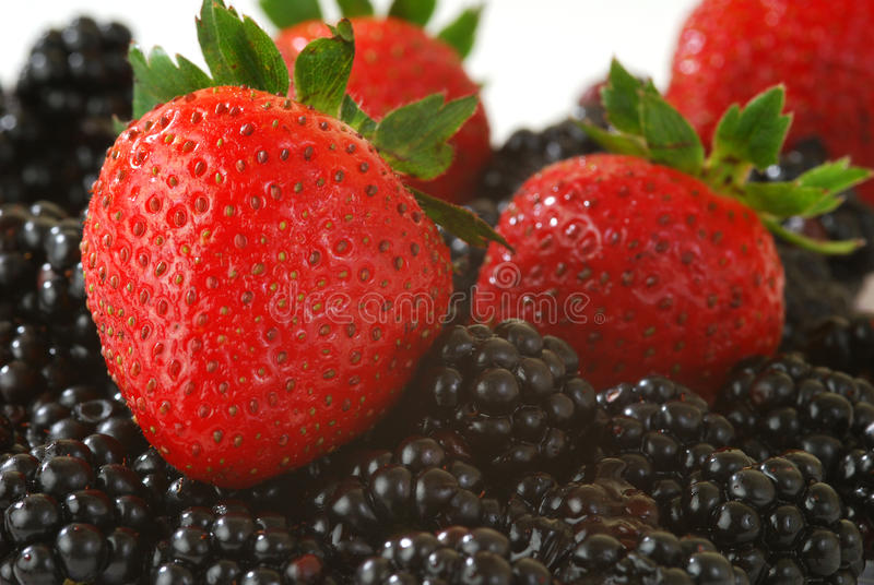 Fresh Strawberries and Blackberries stock images