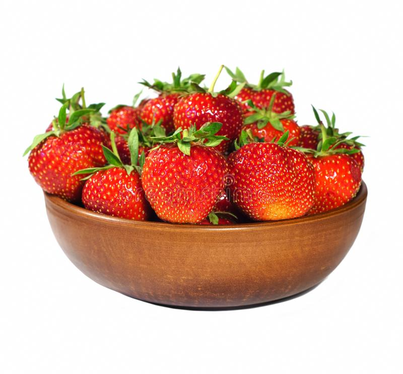 Fresh strawberries in a ceramic plate on a white isolated background royalty free stock photography