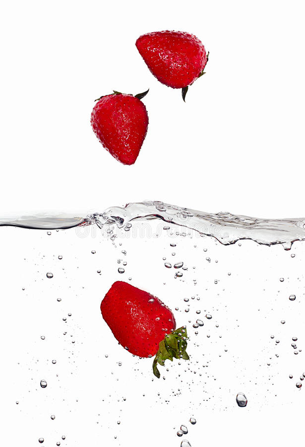 Fresh Strawberries in Falling in Water on stock photo
