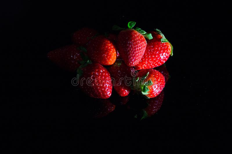 Fresh strawberries isolated on black background with reflections royalty free stock image