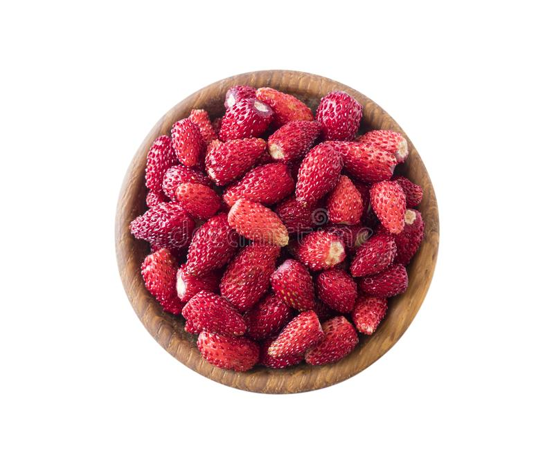 Fresh strawberries lay on white background. Top view. Wildberries on a wooden bowl. Ripe wild strawberry isolated on a white backg. Round. Wild strawberries with stock images