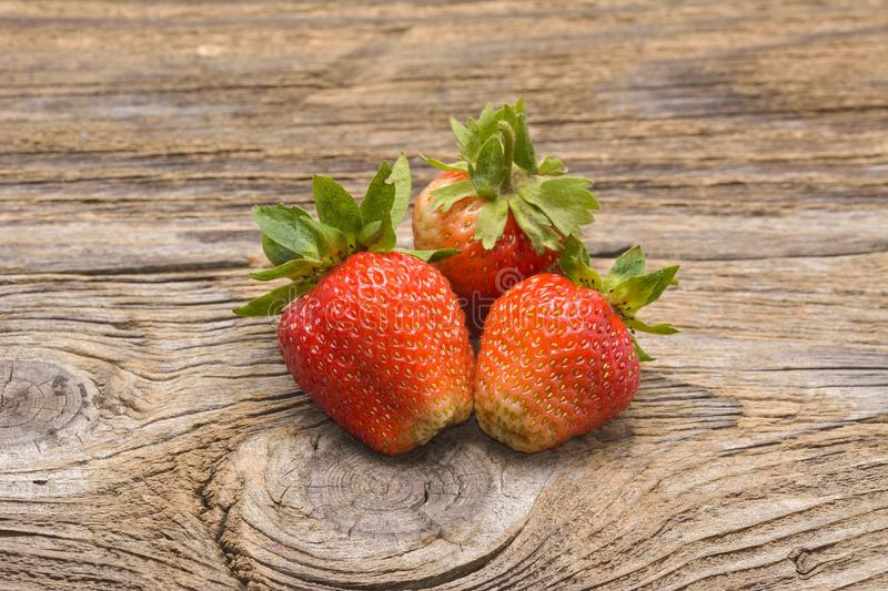 Fresh strawberries on old wooden background stock photo