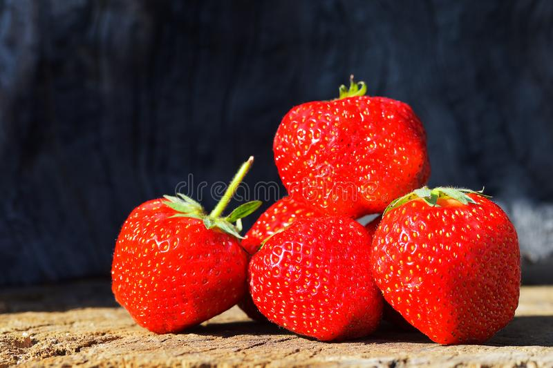 The Fresh strawberries on old wooden background royalty free stock image