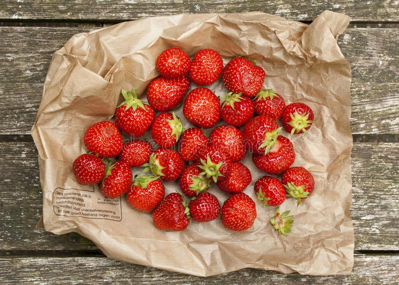 Fresh strawberries on a paper bag stock photos