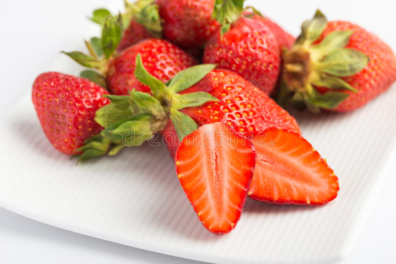 Fresh strawberries in plate royalty free stock image